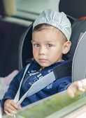 image of seatbelt  - Portrait of Young Caucasian happy Little Boy Sitting on a Car Safety Seat Chair - JPG