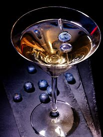 stock photo of cocktail menu  - Dark berry gold drink on black background - JPG