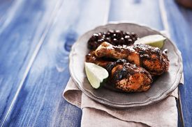 stock photo of jerks  - caribbean jerk chicken and black beans - JPG
