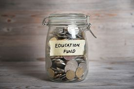 picture of emergency light  - Coins in glass money jar with education fund label - JPG