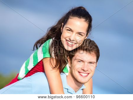 summer holidays, tourism, travel, relations and people concept - group of happy couple having fun outdoors
