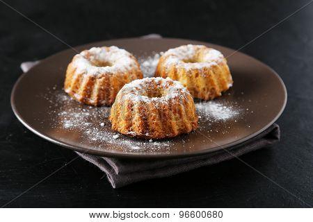 Bundt Cakes On Plate On Black Background
