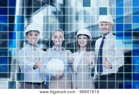 business, architecture, teamwork, gesture and office concept - happy team of architects in office showing thumbs up over blue squared grid background