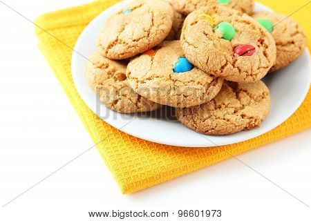 Cookies With Colorful Candy On Plate On White Background