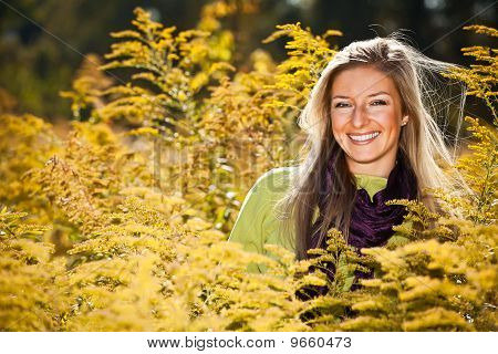 Caucasian young adult blond woman outdoor fall time