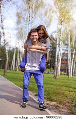Cheerful couple having fun in the park