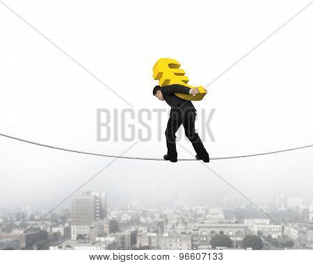 Businessman Carrying Golden Euro Sign Balancing On Tightrope