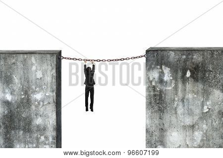 Businessman Hanging Rusty Chain Connected Concrete Walls