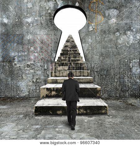 Man Climbing Old Concrete Stairs Toward Keyhole