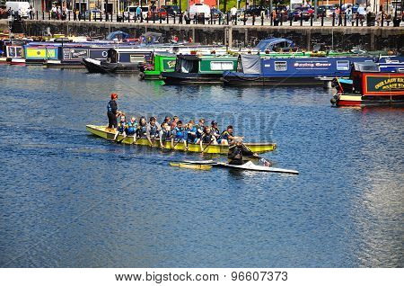 Children rowing in Salthouse Dock.