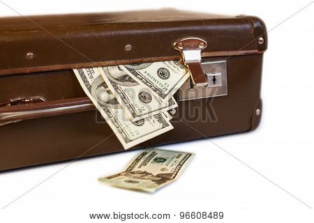 old suitcase with money on a white background