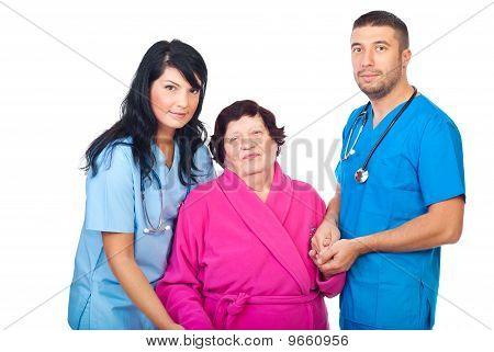 Caring Doctors With Elderly Patient