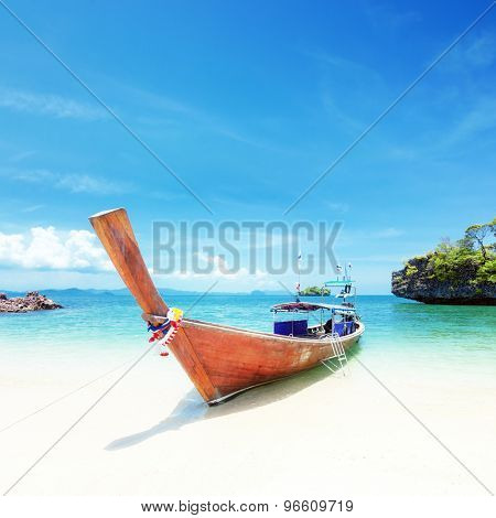Adventure background. Wooden tourist boat on shore of Asian tropical resort. Traveling to Thailand