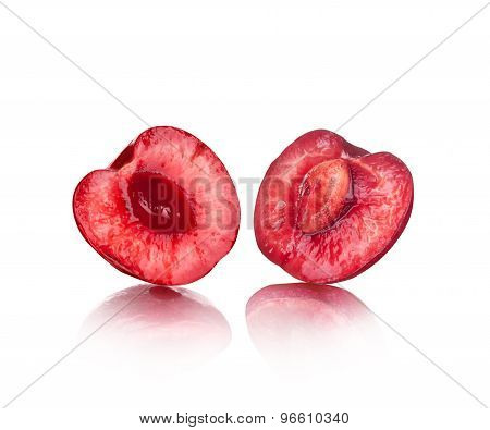 The Two Halves Of Juicy Cherries On An Isolated Background