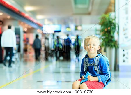 cute little boy waiting in the airport