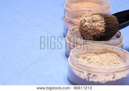 Makeup Brush With Loose Cosmetic Powder Different Shades