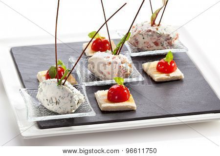 Cream Cheese with Salmon, Tomato and Herbs. Garnished with Toast