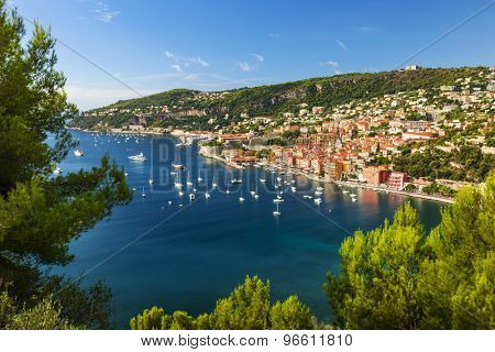 Aerial view of scenic French Riviera mediterranean coast with medieval coastal town Villefranche-sur-Mer, Cap de Nice and leisure boats anchored in harbor