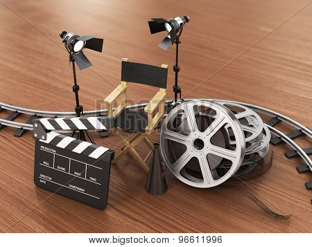 Video, Movie, Cinema Concept. Light, Film Strip, Reels, Rails, Clapperboard And Director Chair On Th
