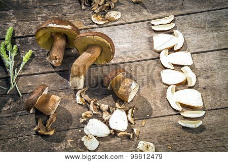 Boletus Edilus Mushrooms On A Wooden Table  – Fresh Dried And Sliced