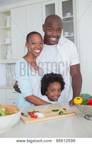 Portrait of a happy familily preparing vegetables together in the kitchen