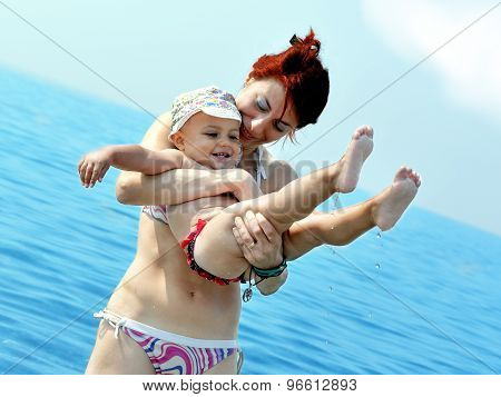 baby and mother into the sea