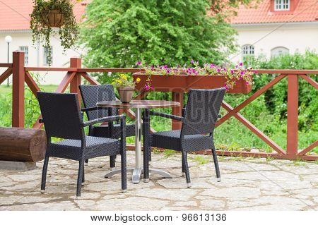 Table And Chairs Of Traditional European Outdoor Cafe