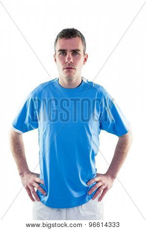 Portrait of a serious rugby player with hands on hips