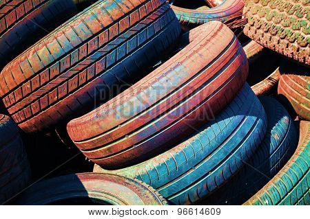 Heap Of Old Colorful Worn-out Car Tires
