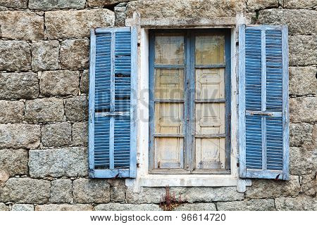 Old Window With Blue Open Shutters