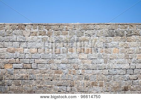 Old Gray Stone Wall And Blue Sky