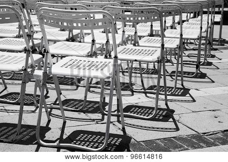 Rows Of Empty White Metal Chairs