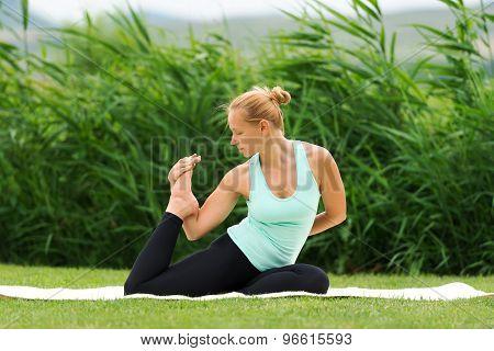 Woman Making Yoga One Legged King Pigeon Pose