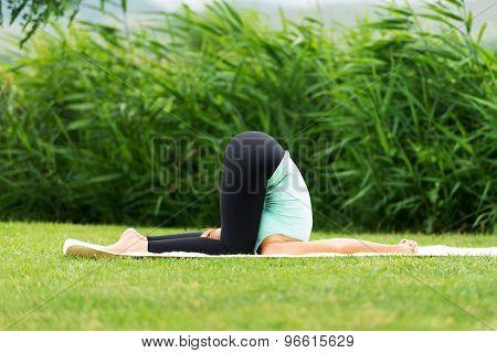 Karnapidasana Deaf Man's Yoga Pose