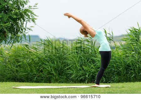 Half Moon Yoga Pose In The Nature