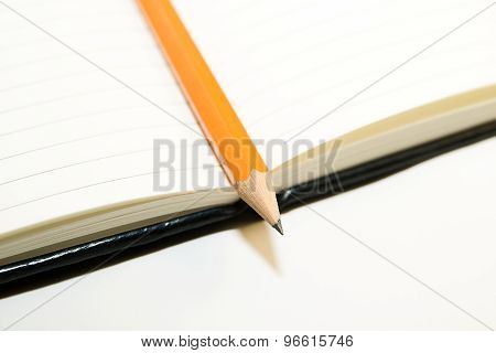 Notepads And Pencil  On A White Background