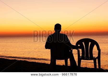 Man On Chair Alone