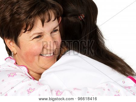 Senior Woman And Nurse Hugging