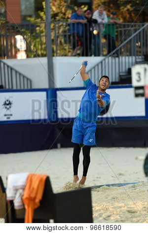 MOSCOW, RUSSIA - JULY 19, 2015: Marco Garavini of Italy serves the ball in the final match of the Beach Tennis World Team Championship against Russia. Italy become world champion