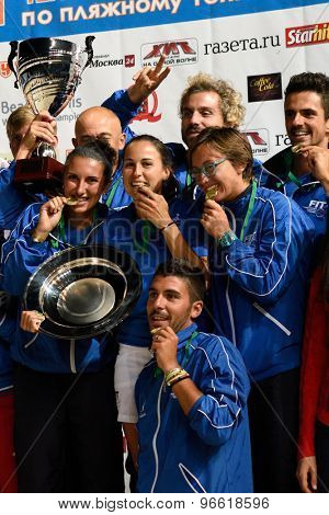 MOSCOW, RUSSIA - JULY 19, 2015: Team Italy with prizes during the Beach Tennis World Team Championship. Italy become world champion, Russia won silver, and Spain got bronze