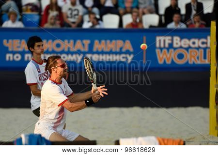 MOSCOW, RUSSIA - JULY 19, 2015: Sergey Kuptsov (in front) and Nikita Burmakin of Russia in the final match of the Beach Tennis World Team Championship against Italy. Italy become world champion