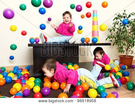 Young Girl Child Having Fun Playing With Colorful Plastic Balls