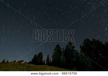 Nightly landscape with star traiis. Astrophotography with a night sky