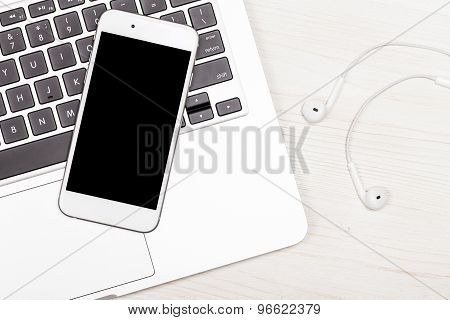 Mobile Phone And Laptop On The Table