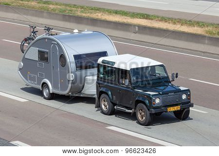 Land Rover Defender With A Small Caravan