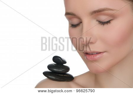 Pile Stones On Shoulder Of Young Woman