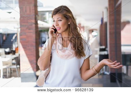 Woman arguing with someone on the telephone at the shopping mall