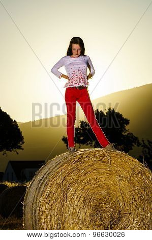 Teenage Girl Posing At The Evening On Haystack, Sunset Colors