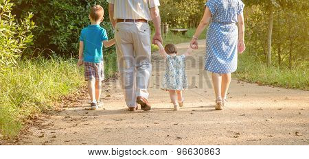 Grandparents and grandchildren walking outdoors