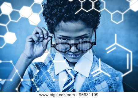 Science graphic against cute little boy holding glasses